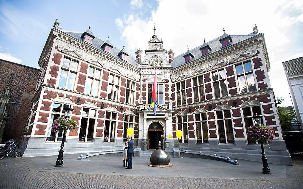 Uit onderzoek van FNV en VAWO uit 2017 komt naar voren dat zeven van de tien medewerkers van de Nederlandse universiteiten de werkdruk hoog tot zeer hoog vinden. Foto: Academiegebouw Universiteit Utrecht. beeld ANP, Jeroen Jumelet