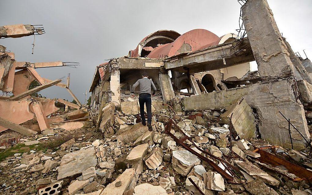 Ook in Syrië vielen talloze christelijke slachtoffers en werden eeuwenoude christelijke steden verwoest. Foto: verwoest kerkgebouw in het Syrische Khabur. beeld EPA, Murtaja Lateef