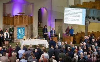 Avondmaalsviering in de Nieuwe Kerk in Kampen, in het kader van verbondenheid tussen GKV en NGK. beeld Freddy Schinkel