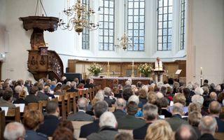 Veel uniformen, gisteren in de Haagse Kloosterkerk. Foto Cees van der Wal