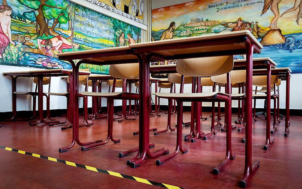 Een leeg klaslokaal in het Amsterdam Lyceum. beeld ANP, Koen van Weel