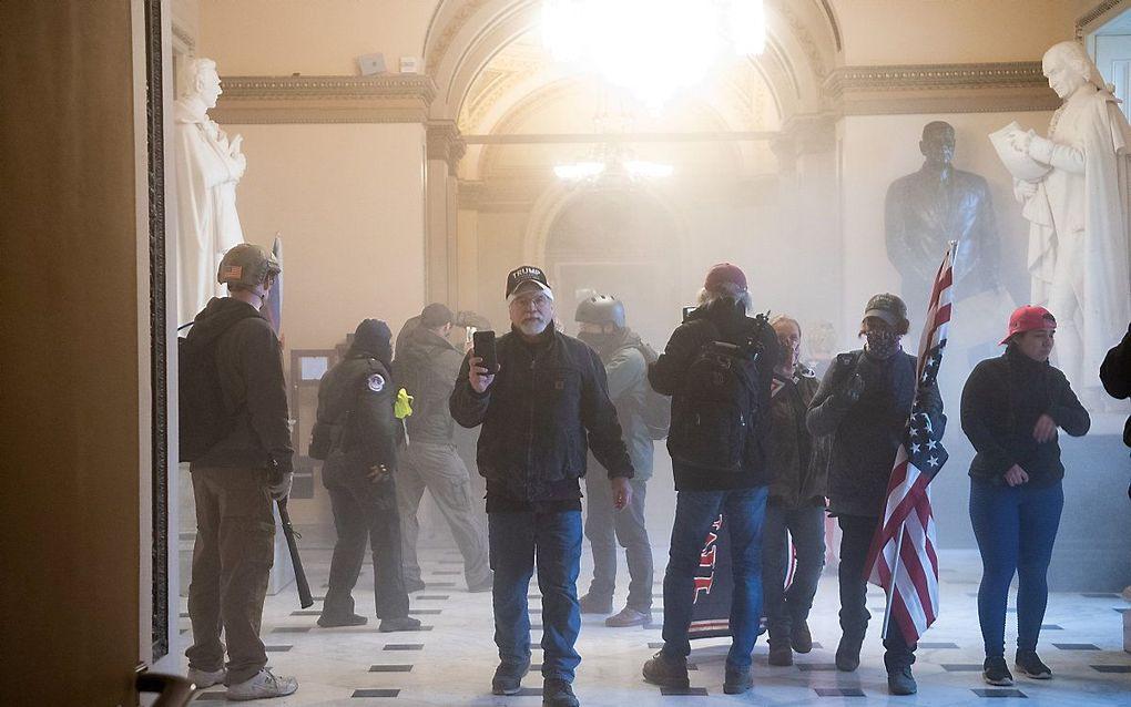 Demonstranten in het Capitool. beeld AFP, SAUL LOEB