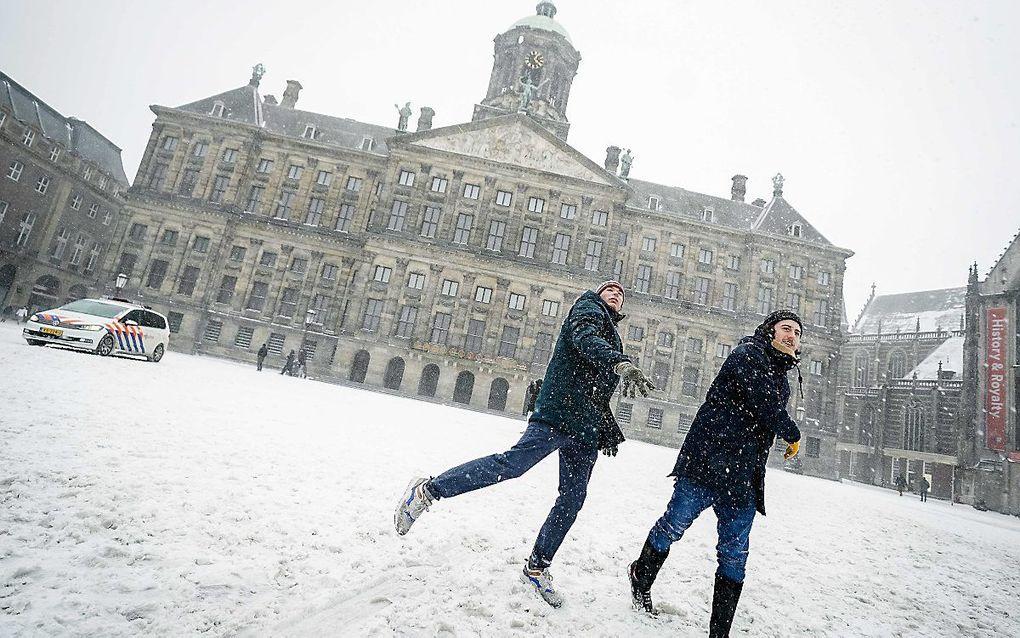 Sneeuwpret in Amsterdam. beeld ANP