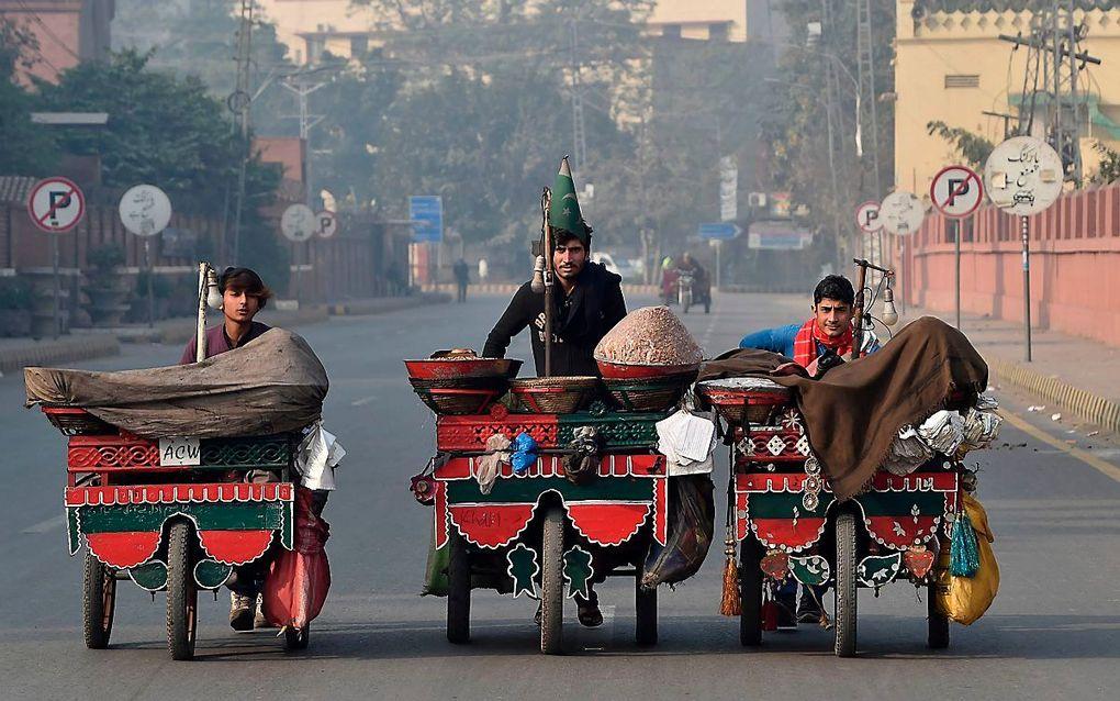 Straatbeeld in Lahore, Pakistan. beeld AFP, Arif Ali