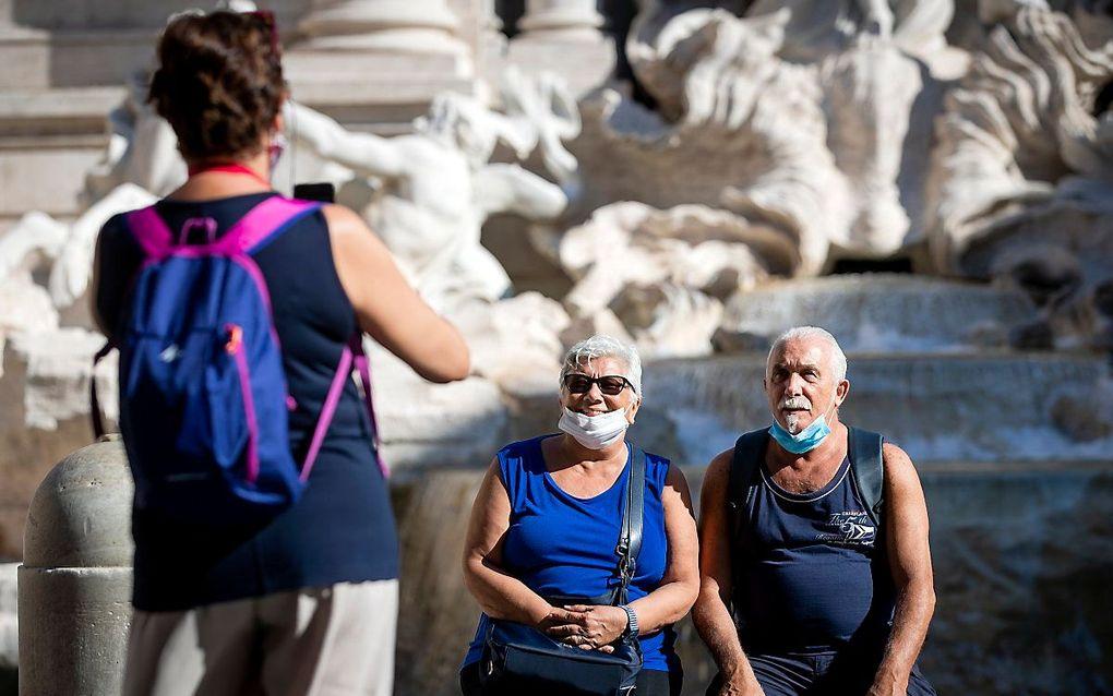 Toeristen bij de Trevifontein in Rome. beeld ANP, Sem van der Wal