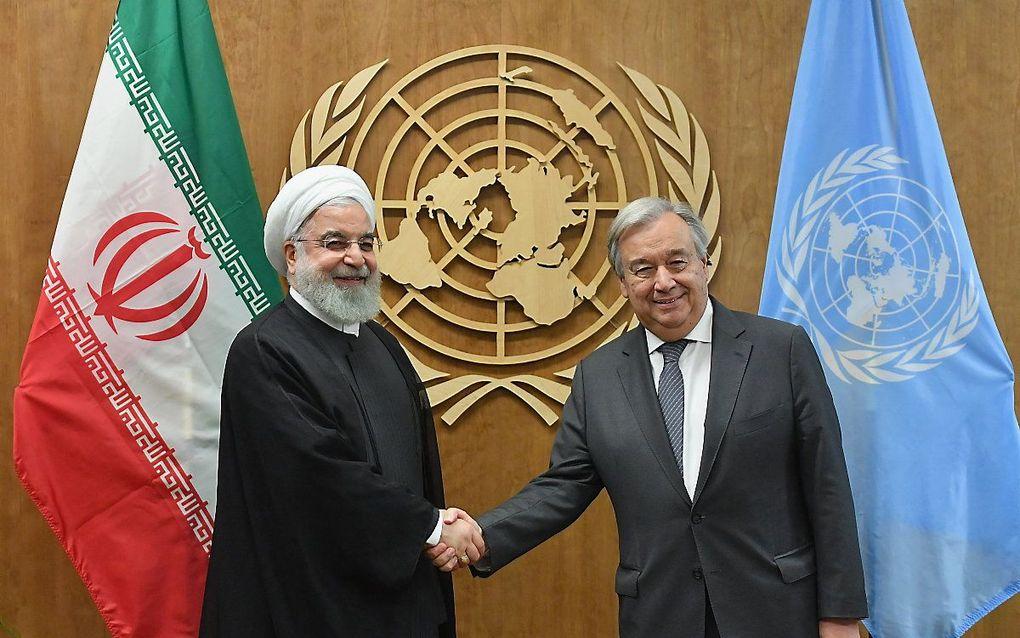 De Iraanse president Hassan Rouhani met de secretaris-generaal van de VN, Antonio Guterres (september 2019). beeld AFP, Angela Weiss