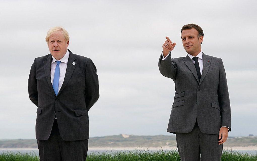 De Britse premier Johnson en de Franse president Emmanuel Macron. beeld AFP
