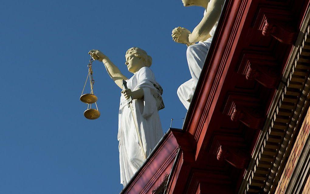 Een beeld van Vrouwe Justitia. beeld ANP XTRA ROOS KOOLE
