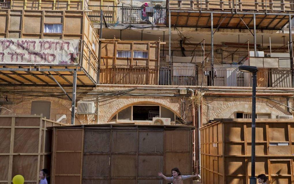 Het zichtbaarste symbool van Soekot is de soeka, de loofhut. beeld EPA, Jim Hollander