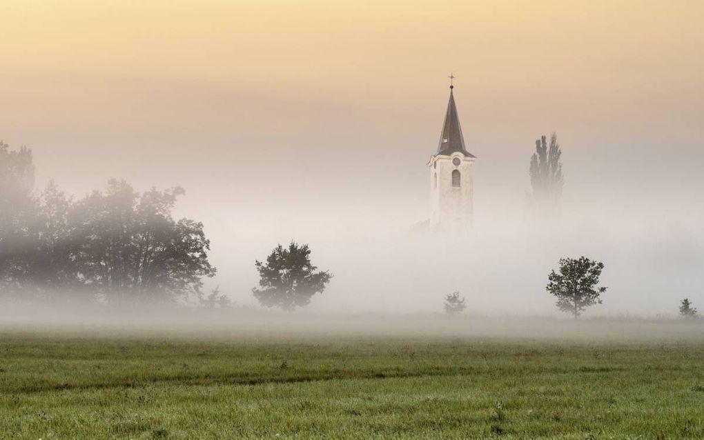 Zal de kerk van de Heere Jezus Christus, dwars tegen de cultuur in, haar heldere getuigenis bewaren en dit getuigenis doen horen aan een wereld die langs een hellend vlak op weg lijkt naar de ondergang? beeld iStock