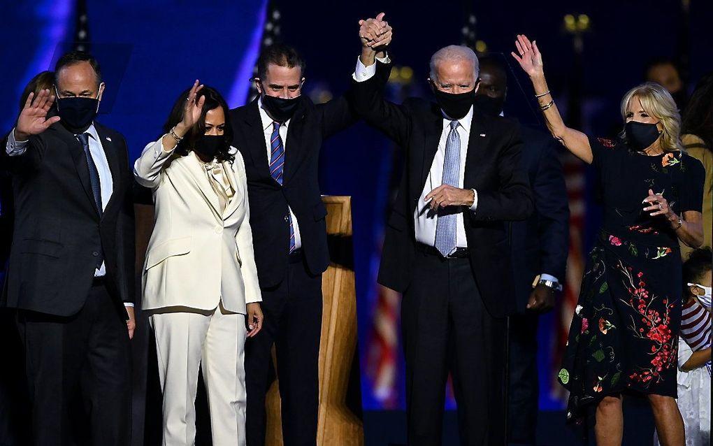 Biden en zijn vrouw en Harris en haar man in Delaware. beeld AFP, Jim WATSON
