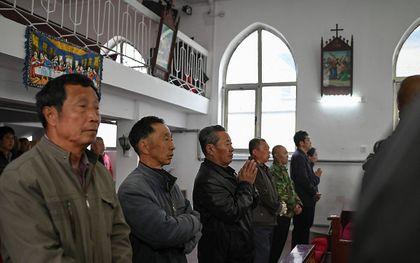 Kerk in Nood (ACN) schenkt in de vijftiende editie van het rapport Vrijheid van Godsdienst Wereldwijd specifieke aandacht aan onder meer de schendingen van godsdienstvrijheid in China. beeld AFP, Jade Gao