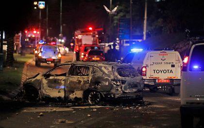 In de Israëlische stad Lod richtten Arabische relschoppers dinsdag ernstige vernielingen aan. beeld AFP