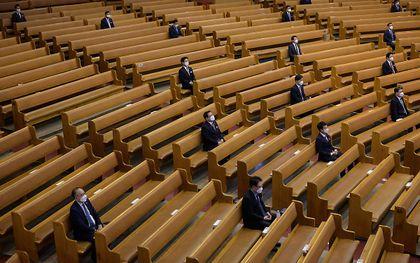 Kerkdienst in coronatijd in China. beeld AFP