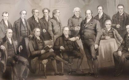 Leiders van particular baptists in Engeland in de achttiende  eeuw. Op de voorste rij zittend geheel links William Carey en Ryland derde van links.beeld Lon Graham