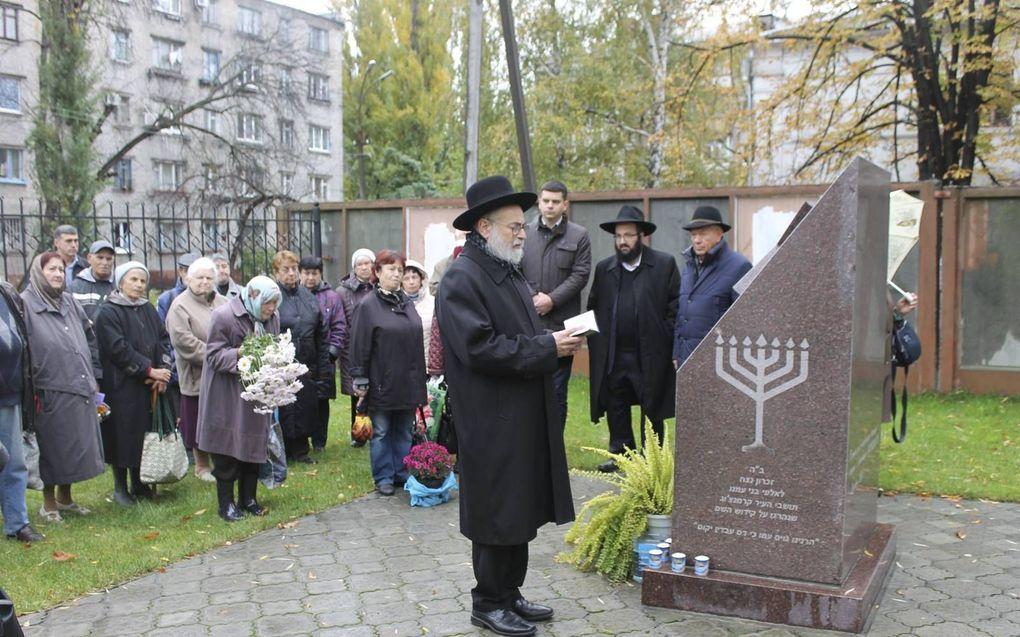 Gebed ter nagedachtenis voor de vermoorde Joden van Krimenchuk in 2018, door opperrabbijn Jacobs.beeld Christenen voor Israël