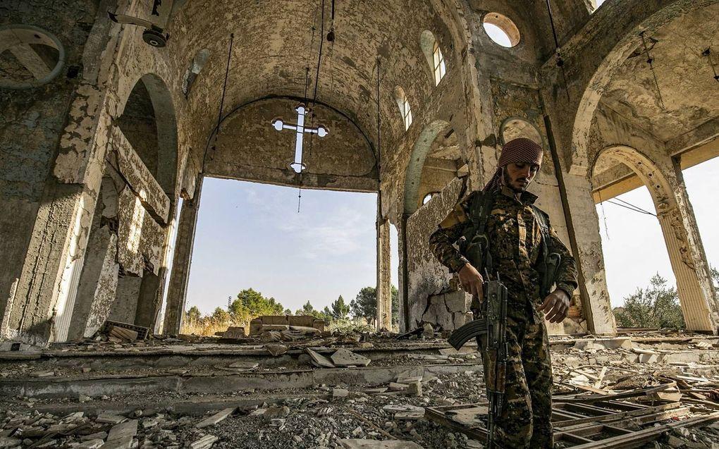 De Assyrische kerk in het dorp Tal Nasri in Syrië, verwoest door strijders van Islamitische Staat in 2019.beeld AFP, Delil Souleiman