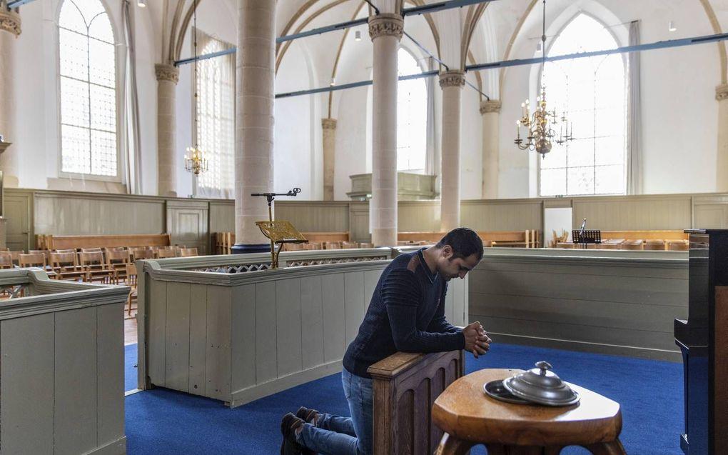 De Iraanse asielzoeker Radin is in 2019 in de Broederkerk in Kampen gedoopt. beeld RD, Henk Visscher