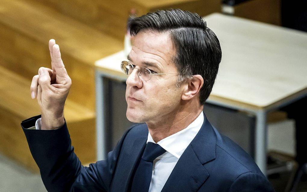 """""""Zorg bij wijze van spreken voor een minister van Communicatie die controleert of een nieuwe regel niet tot meer onduidelijkheid leidt."""" Foto: Premier Rutte wordt gehoord over de toeslagenaffaire.ANP, Remko de Waal"""