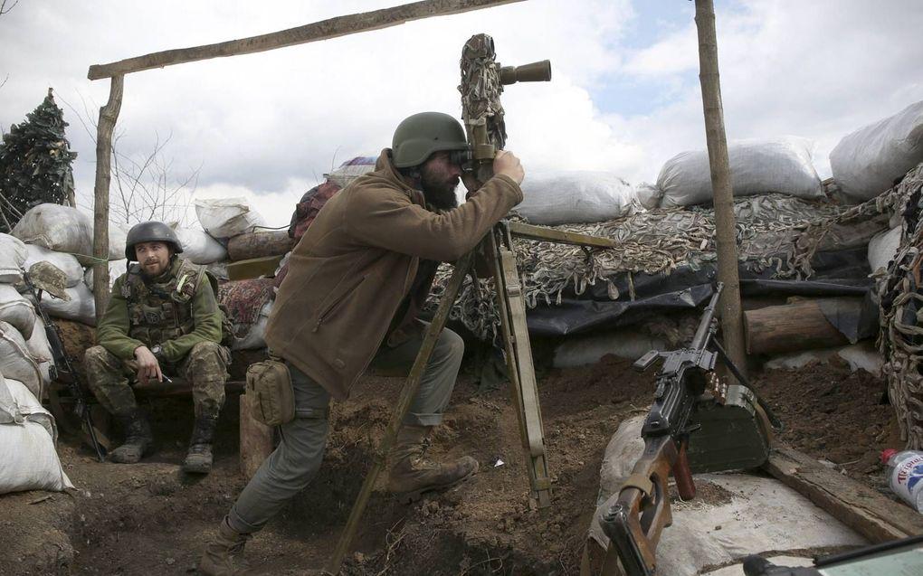"""""""De militaire garanties van Amerika en de NAVO werden door 'Kiev' opgevat als een vrijbrief om de Krim te heroveren en onderweg de afvallige volksrepublieken Donetsk en Loegansk weer in te lijven.""""beeld AFP, Anatolii Stepanov"""
