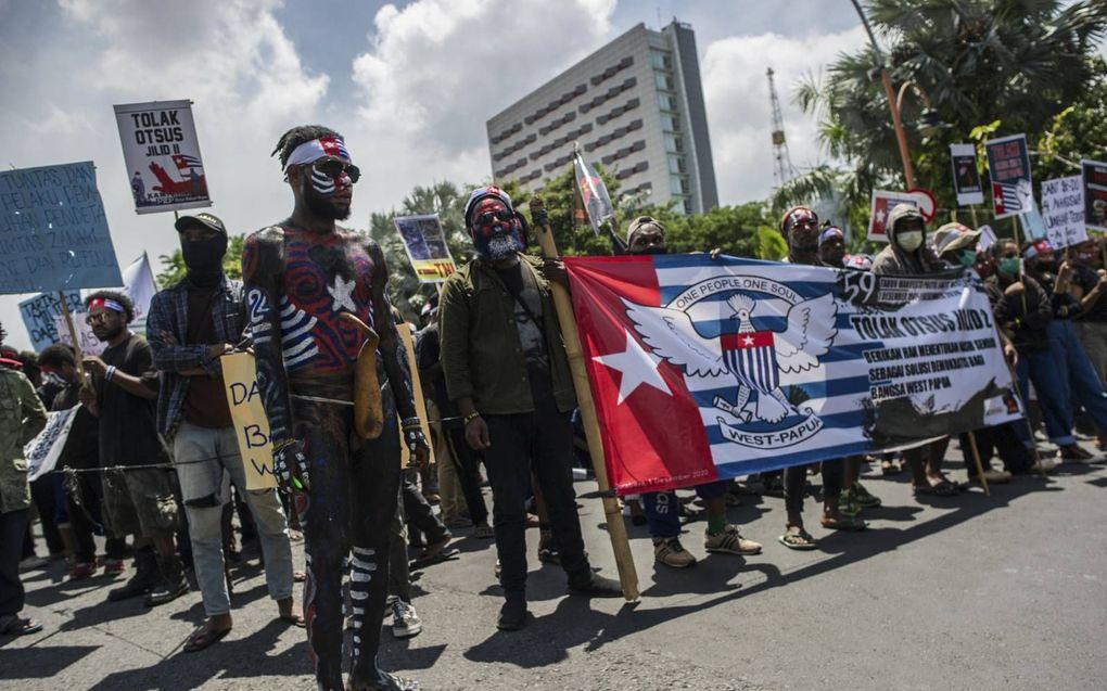Papua's protesteren in het Indonesische Surabaya voor onafhankelijkheid.beeld AFP, Juni Kriswanto