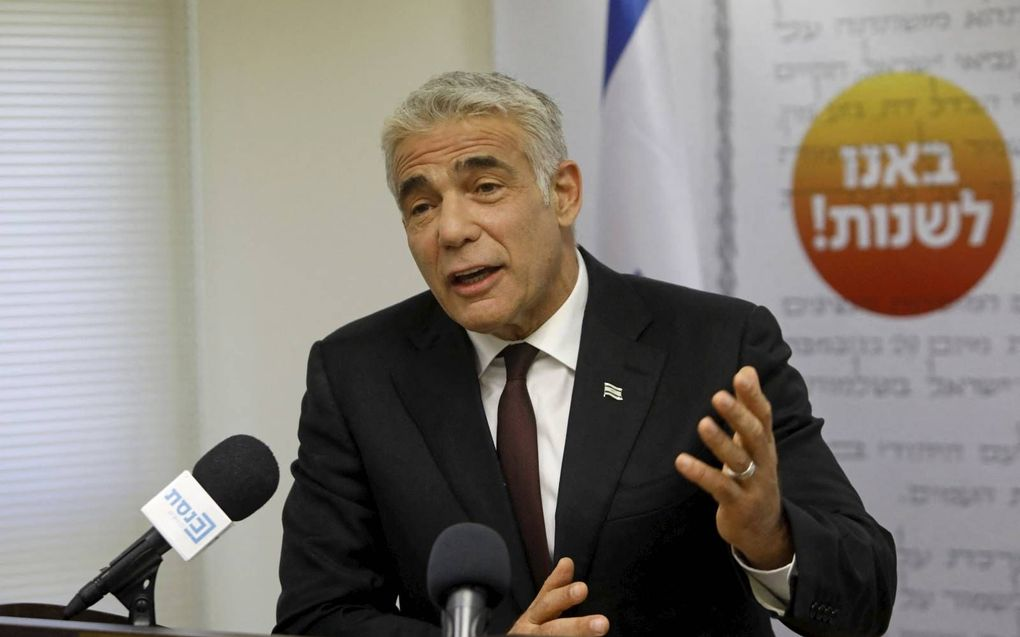"""""""Yair Lapid wist acht zeer verschillende partijen te smeden tot een grote coalitie.""""beeld AFP, Gil Cohen-Magen"""
