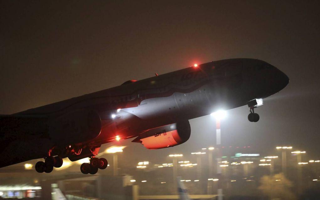 Een vliegvakantie gaat mogelijk heel wat CO2-rechten kosten. beeld EPA, Leszek Szymanski