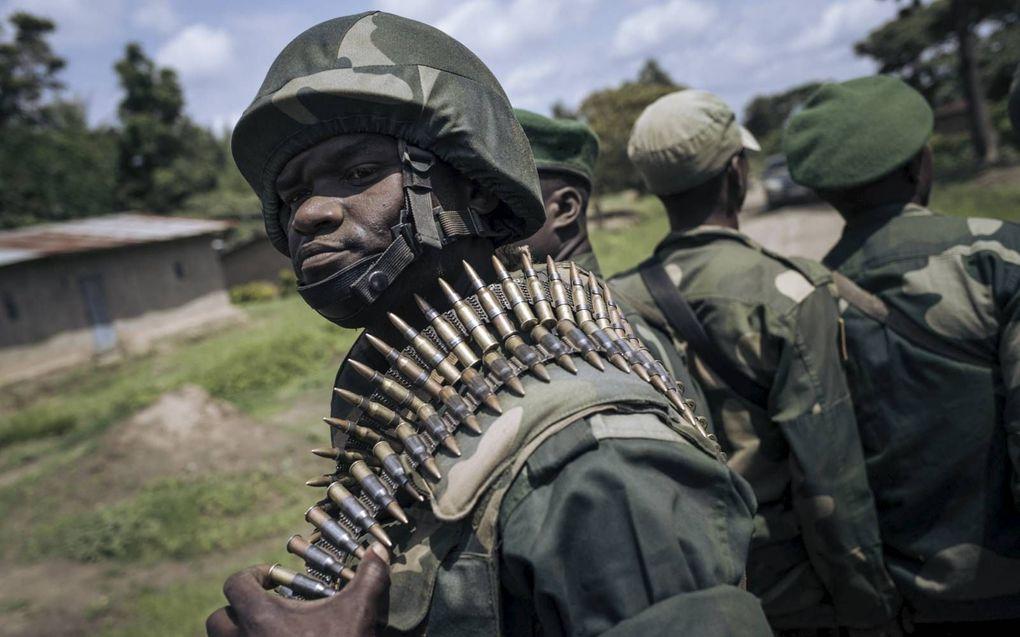Congolese militairen op patrouille in de strijd tegen de gewelddadige islamistische groepering ADF.beeld AFP, Alexis Huguet