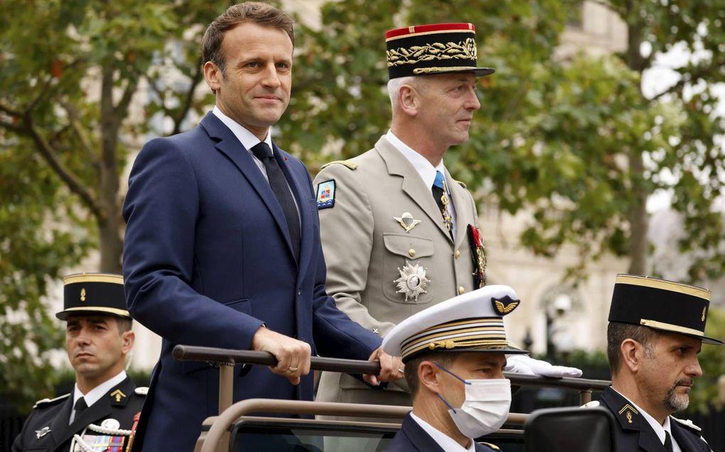 De Franse president Emmanuel Macron en de stafchef van het leger, woensdag tijdens de Franse nationale feestdag Quatorze Juillet.beeld AFP, Ludovic Marin