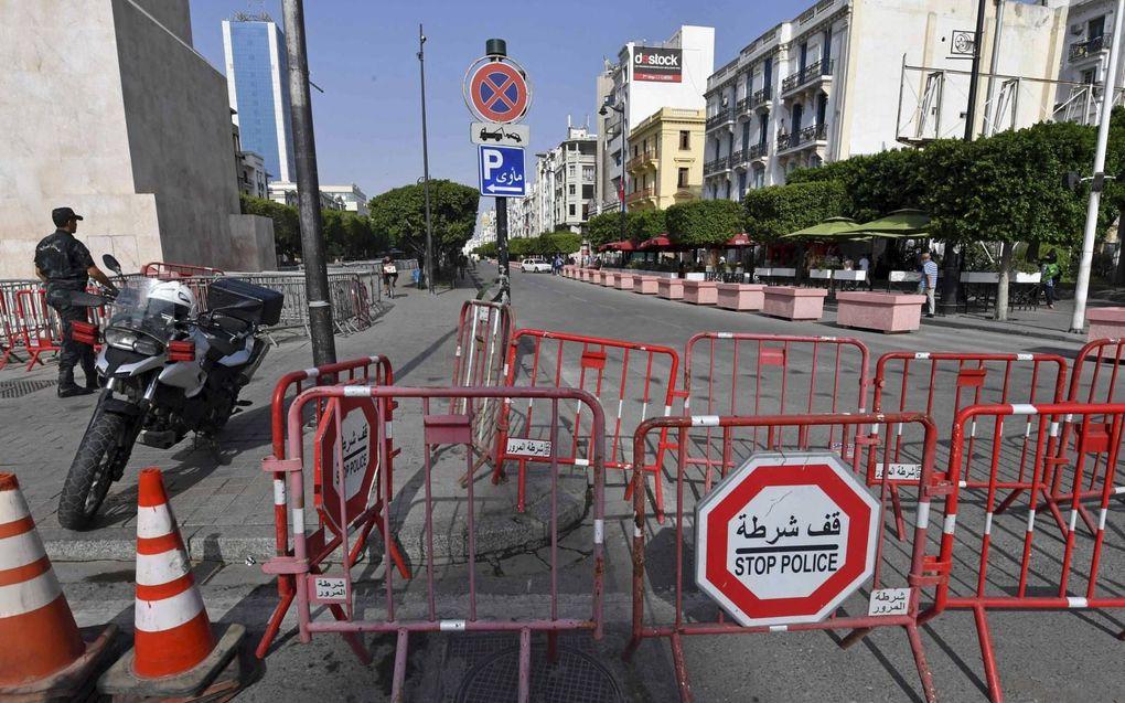 Wegversperring in Tunis.beeld AFP, Fethi Belaid