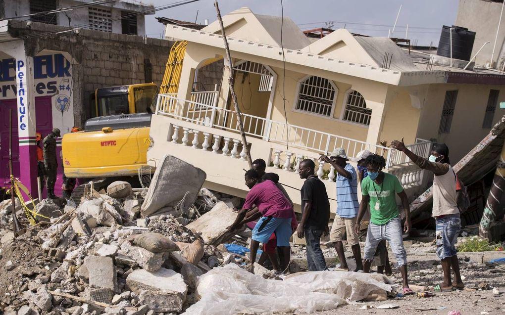 """""""Het is stil in de media, maar niet in Haïti.""""beeld EPA, Orlando Barria"""