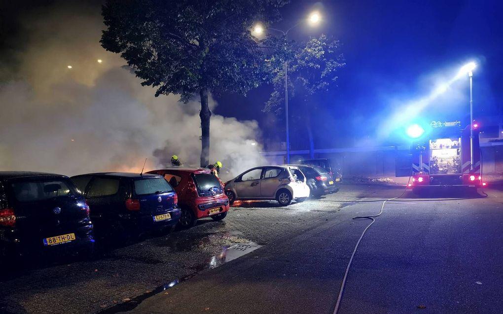 De brandweer bij een brandstichting in de Edese wijk Veldhuizen. beeld ANP, AS Media