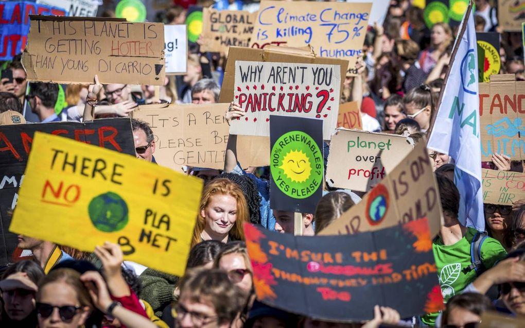 """De klimaatcrisis is een generatieconflict geworden, aldus prof. dr. Jan Hoogland. """"Een hoopvol perspectief is nodig."""" beeld ANP, Marcel van Hoorn"""
