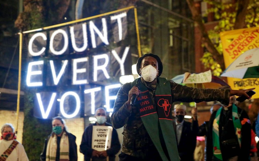 """Predikant Bianca Davis-Lovelace van de """"Washington State Poor People's Campaign"""" vroeg woensdag in Seattle aandacht voor het lot van arme Amerikanen.beeld AFP, Jason Redmond"""