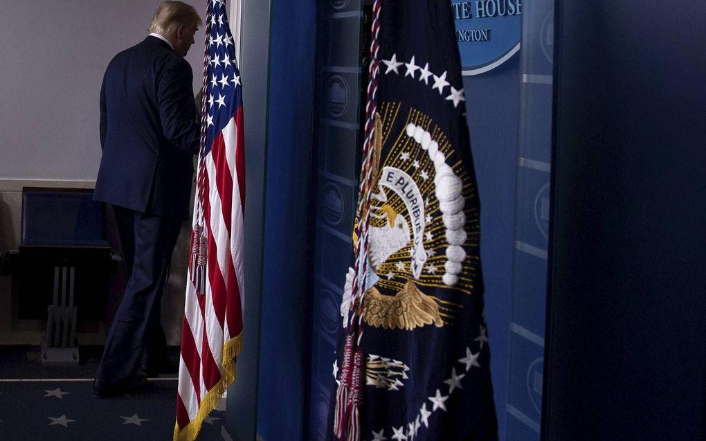 Diverse tv-stations onderbraken donderdagavond de speech van Trump.beeld AFP, Brendan Smialowski