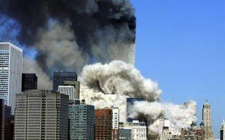 Brandend WTC na de aanslagen.beeld AFP, Hennny Ray Abrams