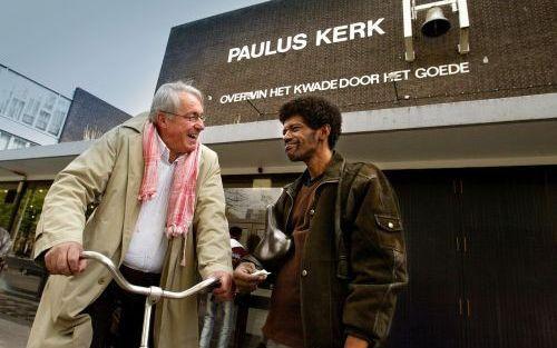 ROTTERDAM – Dominee Hans Visser (l.) heeft ten onrechte miljoenen euro's aan subsidie opgestreken, aldus schrijver Peter Siebelt. Foto ANP