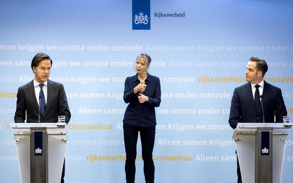 Minister-president Mark Rutte en minister Hugo de Jonge (Volksgezondheid, Welzijn en Sport) tijdens de persconferentie over de coronamaatregelen. beeld ANP SEM VAN DER WAL